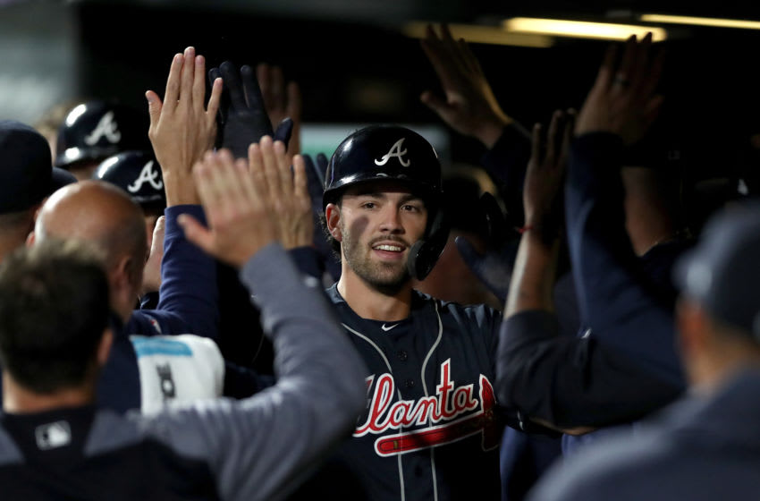 DENVER, COLORADO - APRIL 09: Dansby Swanson #7 of the Atlanta Braves is congratulated in the dugout after hitting a 3 RBI home run in the fourth inning against the Colorado Rockies at Coors Field on April 09, 2019 in Denver, Colorado. (Photo by Matthew Stockman/Getty Images)