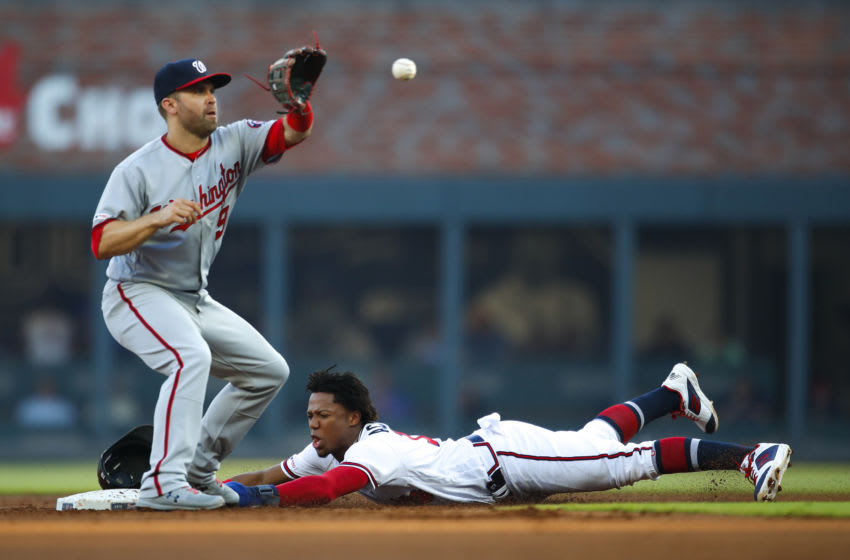 ATLANTA, GA - MAY 28: Ronald Acuna Jr. #13 of the Atlanta Braves steals second base ahead of the throw to Brian Dozier #9 of the Washington Nationals in the first inning of an MLB game at SunTrust Park on May 28, 2019 in Atlanta, Georgia. (Photo by Todd Kirkland/Getty Images)