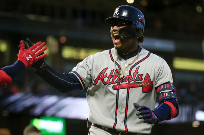 SAN FRANCISCO, CALIFORNIA - MAY 20: Ronald Acuna Jr. #13 of the Atlanta Braves celebrates a home run during the seventh inning against the San Francisco Giants at Oracle Park on May 20, 2019 in San Francisco, California. (Photo by Daniel Shirey/Getty Images)