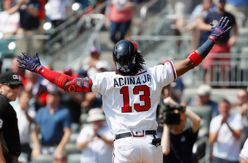 ATLANTA, GEORGIA - SEPTEMBER 19: Ronald Acuna Jr. #13 of the Atlanta Braves crosses home plate after hitting his 40th homer in the third inning against the Philadelphia Phillies at SunTrust Park on September 19, 2019 in Atlanta, Georgia. (Photo by Kevin C. Cox/Getty Images)