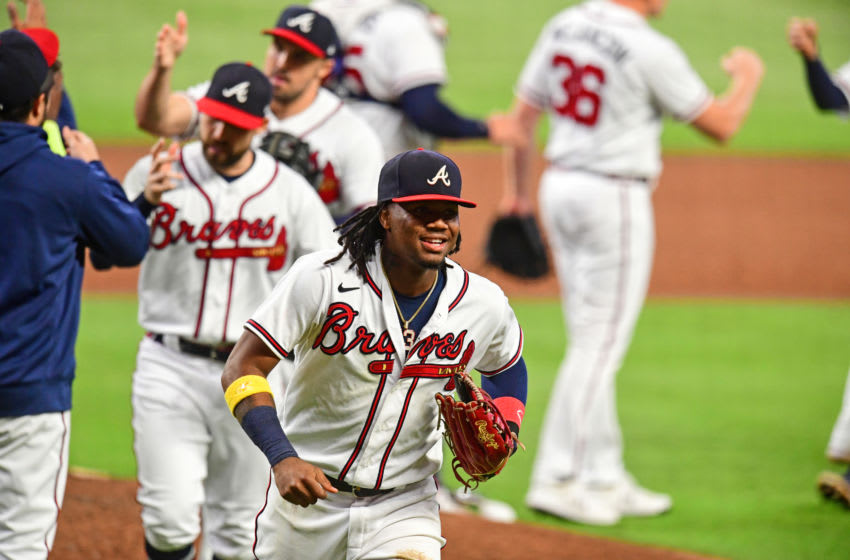 ATLANTA, GA - SEPTEMBER 21: Ronald Acuna Jr. #13 of the Atlanta Braves celebrates after the game against the Miami Marlins at Truist Park on September 21, 2020 in Atlanta, Georgia. (Photo by Scott Cunningham/Getty Images)