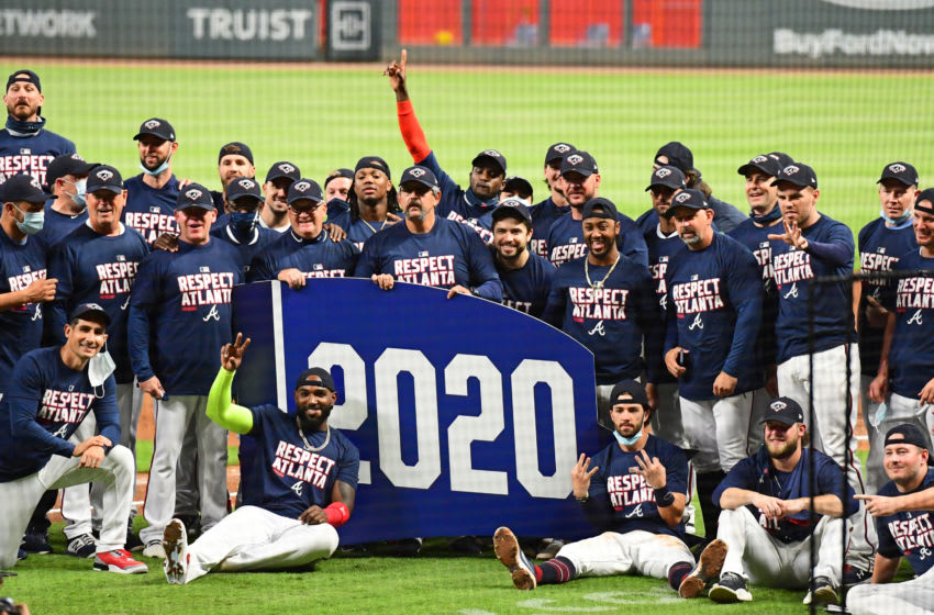 The Atlanta Braves celebrate after winning the NL East Division title against the Miami Marlins at Truist Park on September 22, 2020 (Photo by Scott Cunningham/Getty Images)
