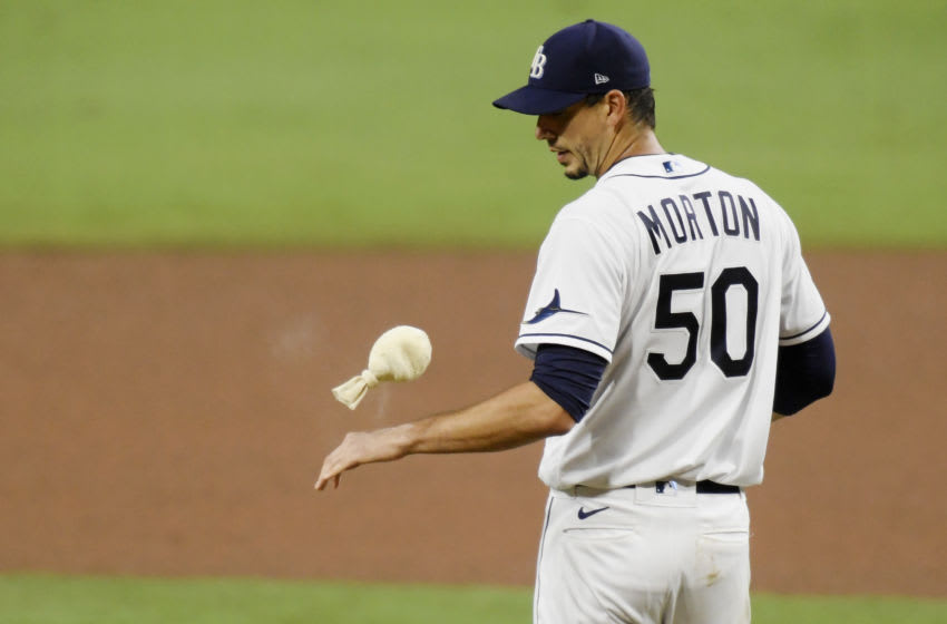 SAN DIEGO, CALIFORNIA - OCTOBER 17: Charlie Morton #50 of the Tampa Bay Rays reacts to walking Martin Maldonado #15 of the Houston Astros during the sixth inning in Game Seven of the American League Championship Series at PETCO Park on October 17, 2020 in San Diego, California. (Photo by Harry How/Getty Images)