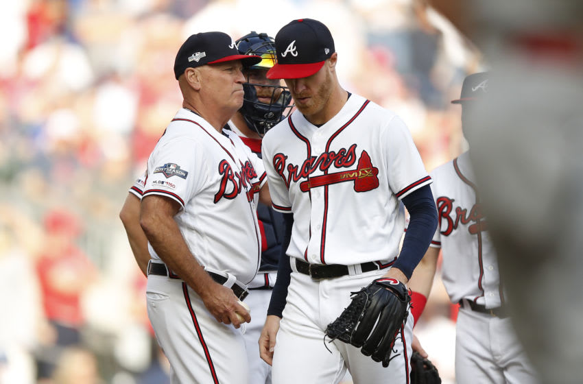 ATLANTA, GEORGIA - OCTOBER 09: Mike Foltynewicz #26 of the Atlanta Braves is removed from the game against the St. Louis Cardinals during the first inning in game five of the National League Division Series at SunTrust Park on October 09, 2019 in Atlanta, Georgia. (Photo by Todd Kirkland/Getty Images)