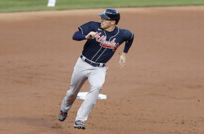 Freddie Freeman of the Atlanta Braves with some wind behind him. (Photo by Jim McIsaac/Getty Images)