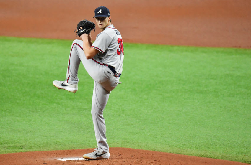 ST PETERSBURG, FLORIDA - JULY 28: Kyle Wright #30 of the Atlanta Braves pitches against the Tampa Bay Rays during the first inning at Tropicana Field on July 28, 2020 in St Petersburg, Florida. (Photo by Julio Aguilar/Getty Images)