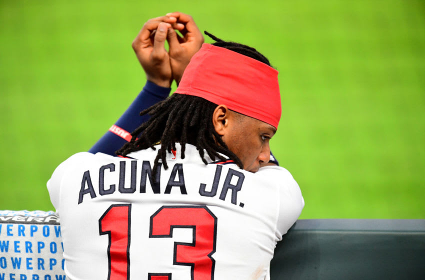 ATLANTA, GA. - AUGUST 1: Ronald Acuna, Jr. #13 of the Atlanta Braves relaxes between innings against the New York Mets at Truist Park on August 1, 2020 in Atlanta, Georgia. (Photo by Scott Cunningham/Getty Images)