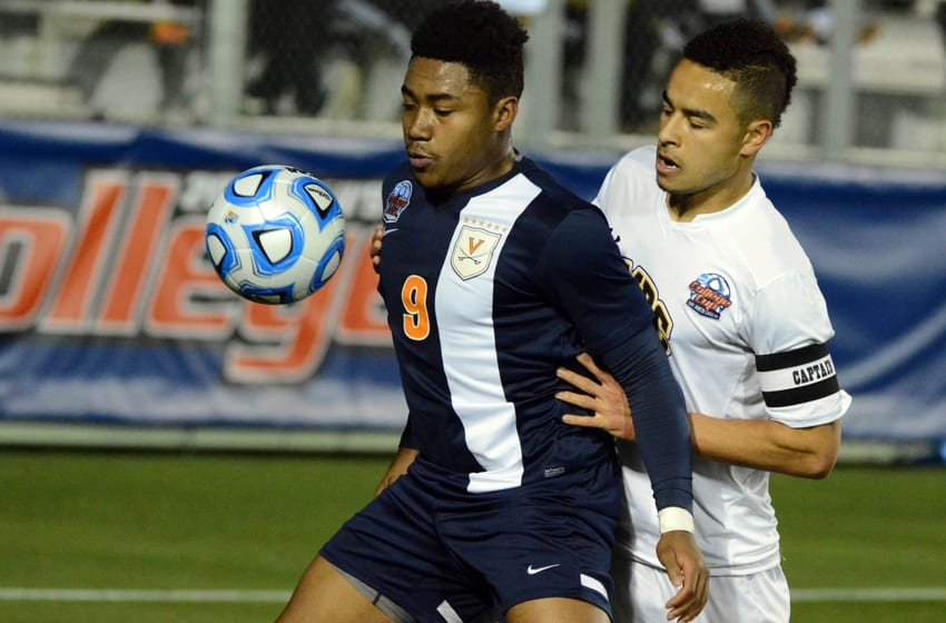 Dec 12, 2014; Cary, NC, USA; Virginia Cavaliers forward Darius Madison (9) controls the ball in front of UMBC Retrievers defender Marquez Fernandez (5)during the first half at Wake Med Soccer Park. Mandatory Credit: Rob Kinnan-USA Today
