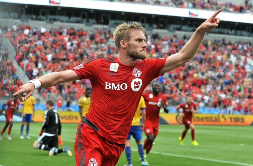 Sep 19, 2015; Toronto, Ontario, CAN; Toronto FC defender Damien Perquis celebrates scoring against Colorado Rapids in the first half at BMO Field. Mandatory Credit: Dan Hamilton-USA TODAY Sports