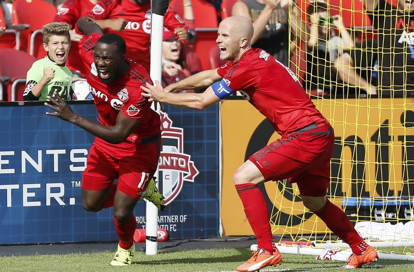 Sep 26, 2015; Toronto, Ontario, CAN; Toronto FC midfielder Michael Bradley (4) reacts to the winning goal against the Chicago Fire by Toronto FC forward Jozy Altidore (left) at BMO Field. Toronto defeated Chicago 3-2. Mandatory Credit: John E. Sokolowski-USA TODAY Sports