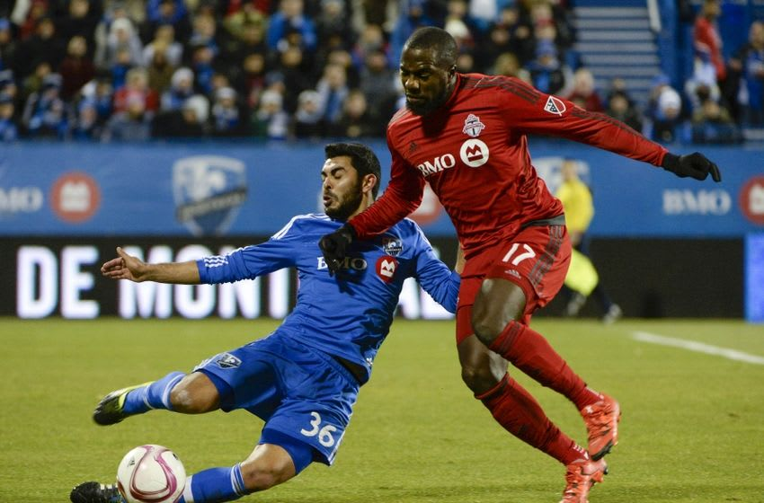 Oct 29, 2015; Montreal, Quebec, CAN; Montreal Impact defender Victor Cabrera (36) kicks the balla wayr from Toronto FC forward Jozy Altidore (17) during the second half of a knockout round match of the 2015 MLS Cup Playoffs at Stade Saputo. Mandatory Credit: Eric Bolte-USA TODAY Sports