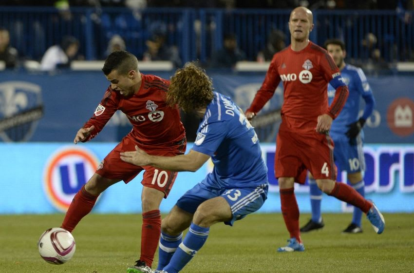 Oct 29, 2015; Montreal, Quebec, CAN; Toronto FC forward Sebastian Giovinco (10) plays the ball and Montreal Impact midfielder Marco Donadel (33) defends during the second half of a knockout round match of the 2015 MLS Cup Playoffs at Stade Saputo. Mandatory Credit: Eric Bolte-USA TODAY Sports