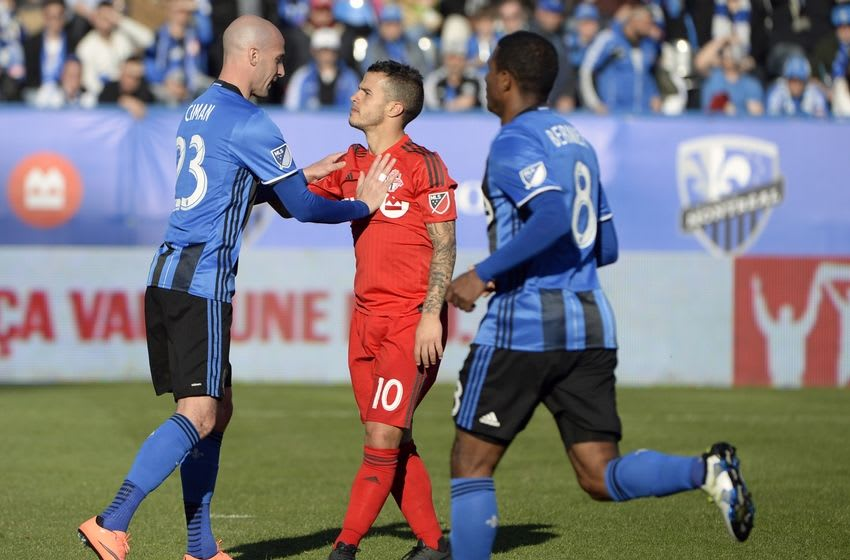 Apr 23, 2016; Montreal, Quebec, CAN; Montreal Impact defender Laurent Ciman (23) pushes Toronto FC forward Sebastian Giovinco (10) during the second half at Stade Saputo. Mandatory Credit: Eric Bolte-USA TODAY Sports