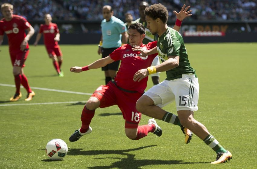 May 1, 2016; Portland, OR, USA; Portland Timbers defender Chris Klute (15) and Toronto FC midfielder Marky Delgado (18) battle for the ball during the first half at Providence Park. Mandatory Credit: Troy Wayrynen-USA TODAY Sports