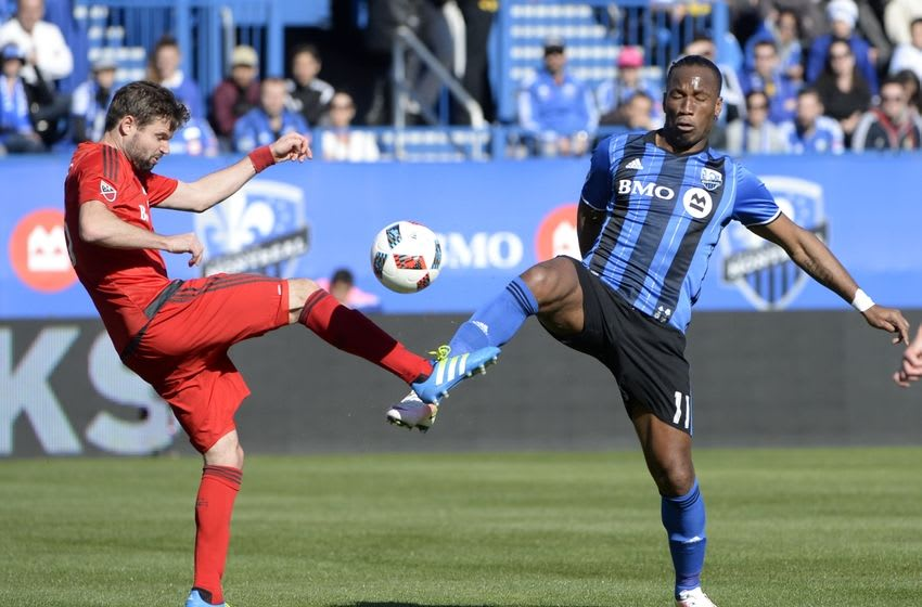 Apr 23, 2016; Montreal, Quebec, CAN; Toronto FC defender Drew Moor (3) and Montreal Impact forward Didier Drogba (11) battle for the ball during the first half at Stade Saputo. Mandatory Credit: Eric Bolte-USA TODAY Sports