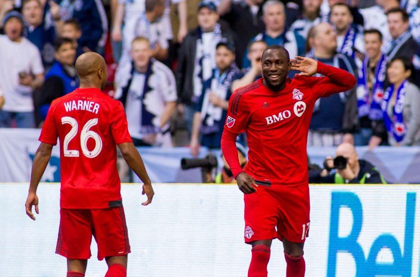 Mar 07, 2015; Vancouver, British Columbia, CAN; Toronto FC midfielder Collen Warner (26) and Toronto FC forward Jozy Altidore (17) celebrate Altidore