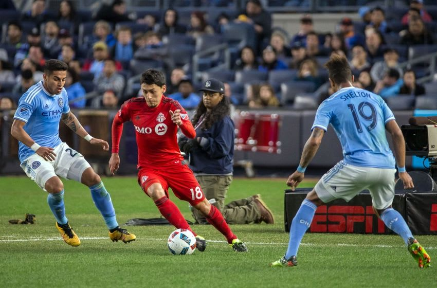 Mar 13, 2016; New York, NY, USA; Toronto FC midfielder Marco Delgado (18) move the ball against the New York City FC during the second half at Yankee Stadium. Toronto tied New York City, 2-2. Mandatory Credit: Vincent Carchietta-USA TODAY Sports