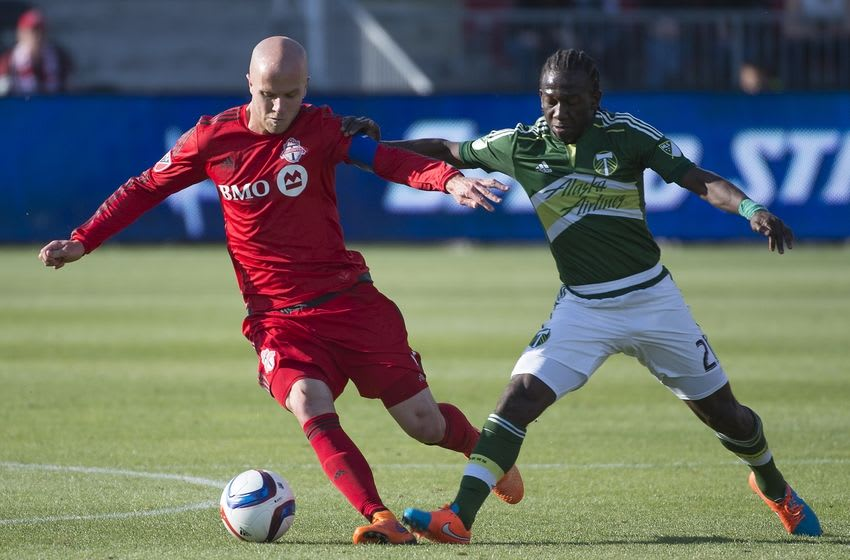 May 23, 2015; Toronto, Ontario, CAN; Portland Timbers midfielder Diego Chara (21) battles with Toronto FC midfielder Michael Bradley (4) during the second half in a game at BMO Field. Toronto FC won 1-0. Mandatory Credit: Nick Turchiaro-USA TODAY Sports