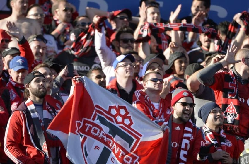 Apr 23, 2016; Montreal, Quebec, CAN; Toronto FC fans react during the second half against the Montreal Impact at Stade Saputo. Mandatory Credit: Eric Bolte-USA TODAY Sports