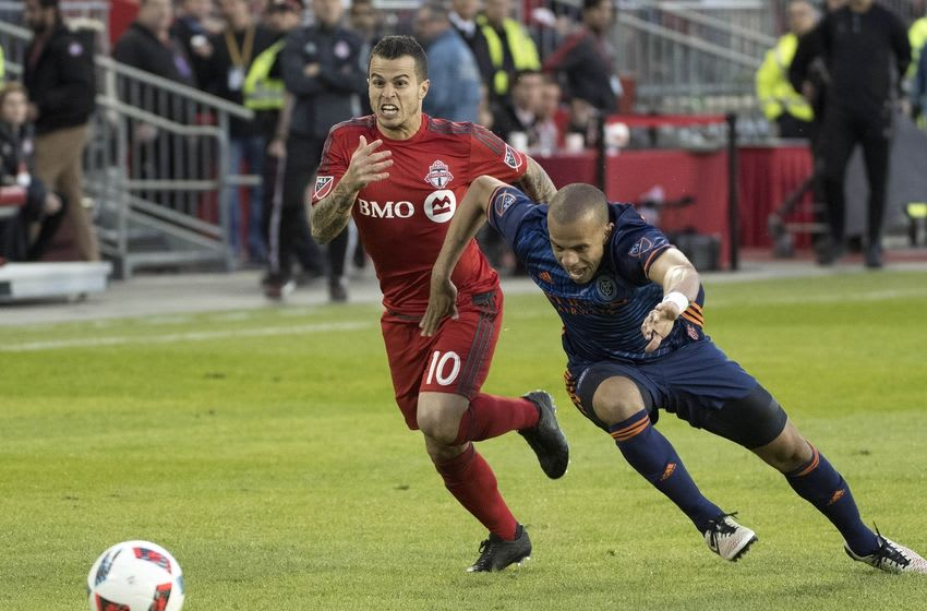 May 18, 2016; Toronto, Ontario, CAN; Toronto FC forward Sebastian Giovinco (10) battles for a ball with New York City FC defender Jason Hernandez (2) during the second half in a game at BMO Field. The game ended in a 1-1 draw. Mandatory Credit: Nick Turchiaro-USA TODAY Sports