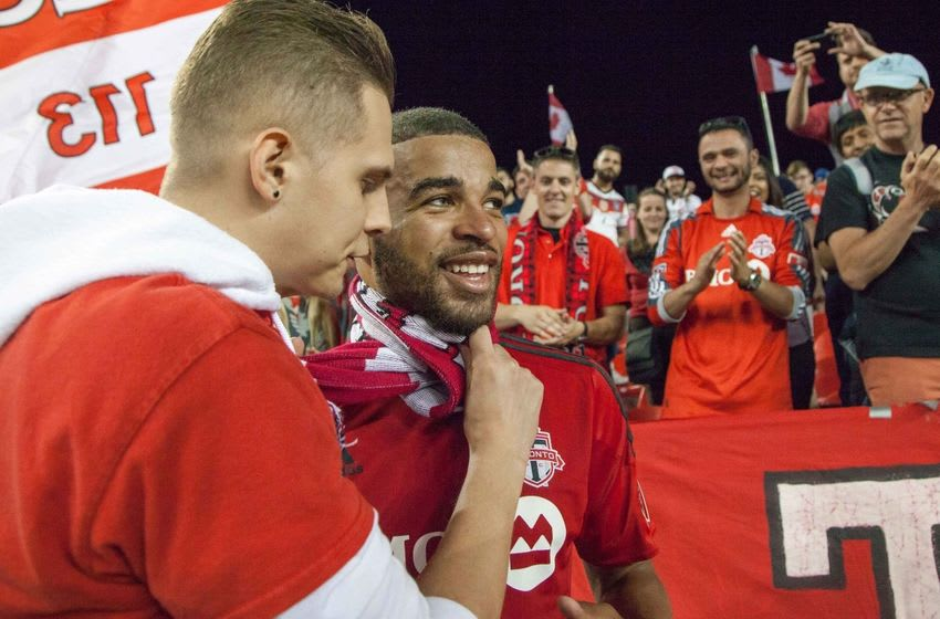 Jun 1, 2016; Toronto, Ontario, Canada; Toronto FC forward Jordan Hamilton (22) is given a scarf by a Toronto FC supporter after defeating the Montreal Impact 4-2 in the Canadian Cup semifinal at BMO Field. Mandatory Credit: Kevin Sousa-USA TODAY Sports