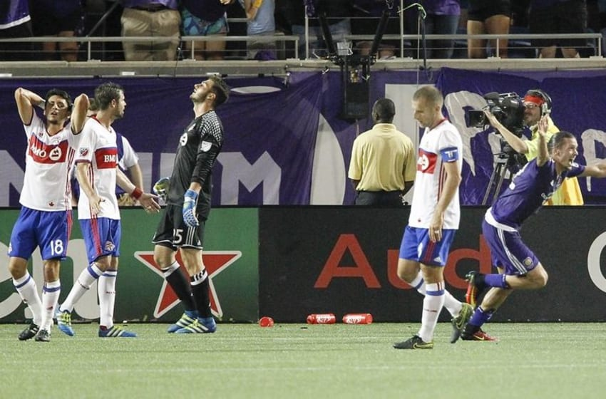 Jun 25, 2016; Orlando, FL, USA; Orlando City FC forward Adrian Winter (right) celebrates a goal against Toronto FC during the second half of a soccer match at Orlando