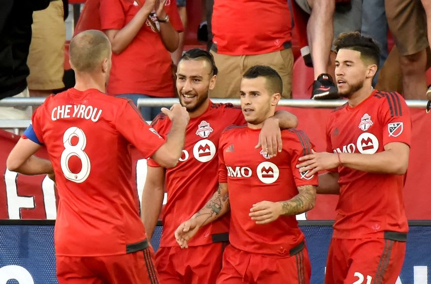 Jun 21, 2016; Toronto, Ontario, CANADA; Toronto FC forward Sebastian Giovinco (10) is greeted by teammates Benoit Cheyrou (8), Mo Babouli(11) and Jonathan Osorio (21) after scoring against Vancouver Whitecaps in the first half at BMO Field. Mandatory Credit: Dan Hamilton-USA TODAY Sports