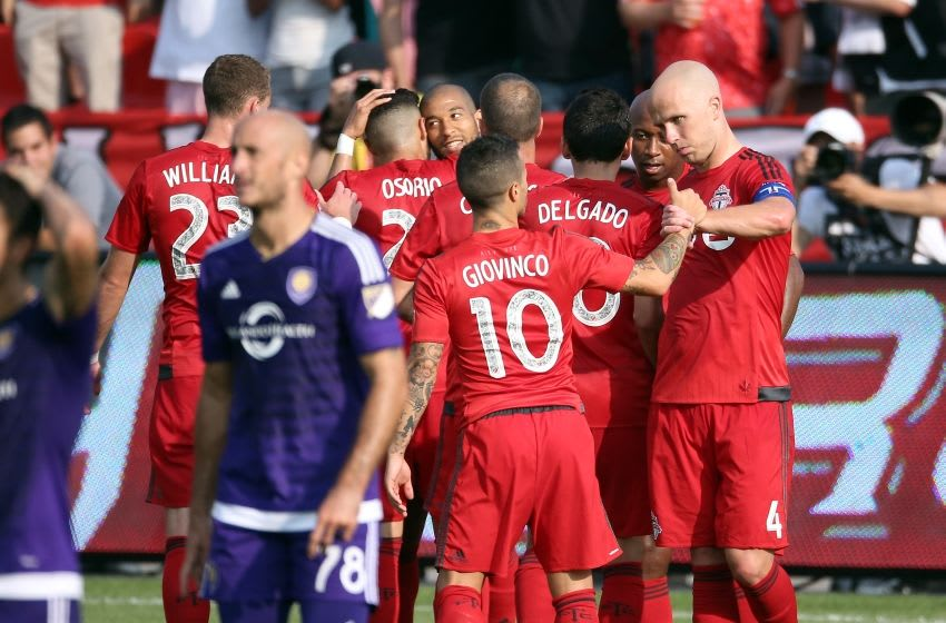 Aug 22, 2015; Toronto, Ontario, CAN; Toronto FC defender Justin Morrow (2) is congratulated on his goal by midfielder Jonathan Osorio (21) as forward Sebastian Giovinco (10) celebrates with midfielder Michael Bradley (4) against the Orlando City SC at BMO Field. Toronto FC beat Orlando City SC 5-0. Mandatory Credit: Tom Szczerbowski-USA TODAY Sports
