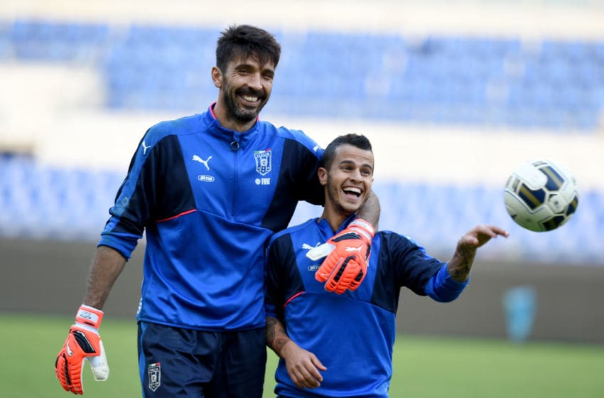 ROME, ITALY - OCTOBER 12: Gianluigi Buffon (L) and Sebastian Giovinco of Italy chat at the end of training session at Stadio Olimpico on October 12, 2015 in Rome, Italy. (Photo by Claudio Villa/Getty Images)