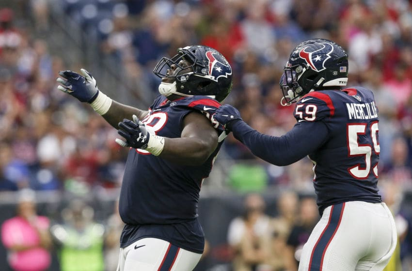 HOUSTON, TX - OCTOBER 06: D.J. Reader #98 of the Houston Texans celebrates with Whitney Mercilus #59 after a sack in the second half against the Atlanta Falcons at NRG Stadium on October 6, 2019 in Houston, Texas. (Photo by Tim Warner/Getty Images)