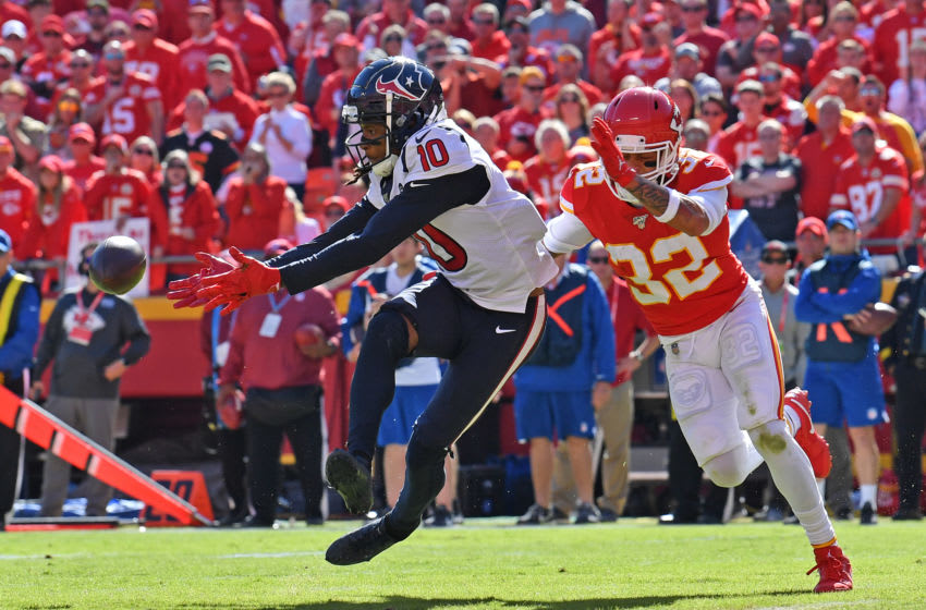 KANSAS CITY, MO - OCTOBER 13: Wide receiver DeAndre Hopkins #10 of the Houston Texans reaches out for the ball against the strong safety Tyrann Mathieu #32 of the Kansas City Chiefs during the second half at Arrowhead Stadium on October 13, 2019 in Kansas City, Missouri. (Photo by Peter Aiken/Getty Images)