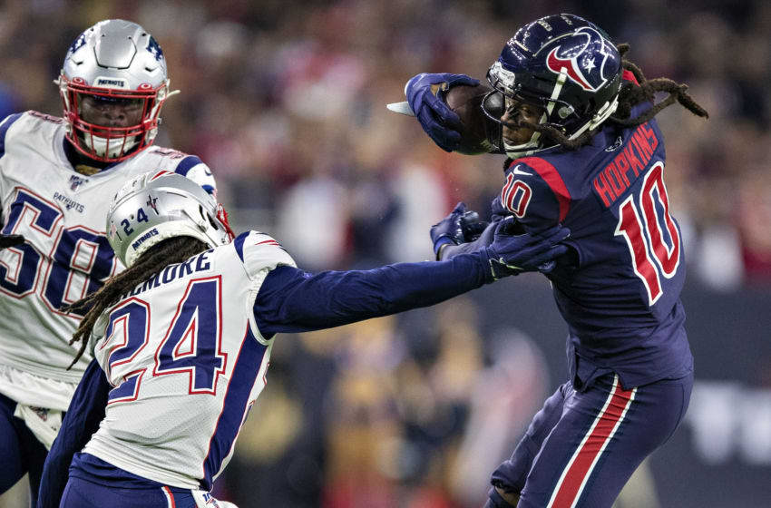 HOUSTON, TX - DECEMBER 1: DeAndre Hopkins #10 of the Houston Texans catches a pass in the second half and tries to avoid the tackle of Stephon Gilmore #24 of the New England Patriots at NRG Stadium on December 1, 2019 in Houston, Texas. The Texans defeated the Patriots 28-22. (Photo by Wesley Hitt/Getty Images)