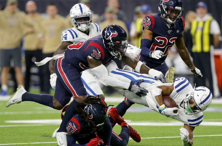 HOUSTON, TEXAS - NOVEMBER 21: Running back Nyheim Hines #21 of the Indianapolis Colts carries the ball against the defense of safety Tashaun Gipson #39 of the Houston Texans during the game at NRG Stadium on November 21, 2019 in Houston, Texas. (Photo by Bob Levey/Getty Images)