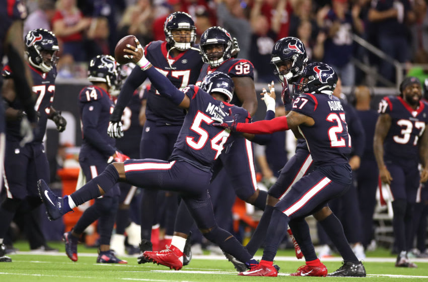 HOUSTON, TEXAS - JANUARY 04: Jacob Martin #54 of the Houston Texans is congratulated by his teammates after recovering a fumble against the Buffalo Bills during the fourth quarter of the AFC Wild Card Playoff game at NRG Stadium on January 04, 2020 in Houston, Texas. (Photo by Christian Petersen/Getty Images)