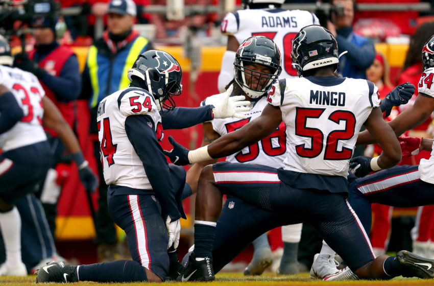 KANSAS CITY, MISSOURI - JANUARY 12: Jacob Martin #54, Peter Kalambayi #58 and Barkevious Mingo #52 of the Houston Texans celebrate a punt block for a touchdown against the Kansas City Chiefs during the first quarter in the AFC Divisional playoff game at Arrowhead Stadium on January 12, 2020 in Kansas City, Missouri. (Photo by Tom Pennington/Getty Images)