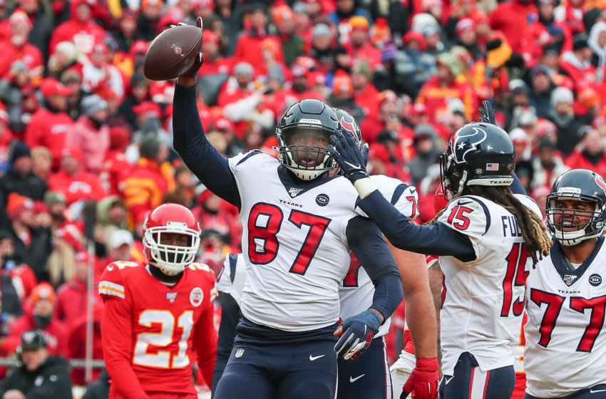 KANSAS CITY, MISSOURI - JANUARY 12: Darren Fells #87 of the Houston Texans is congratulated by his teammates after a touchdown reception against the Kansas City Chiefs during the first quarter in the AFC Divisional playoff game at Arrowhead Stadium on January 12, 2020 in Kansas City, Missouri. (Photo by Tom Pennington/Getty Images)
