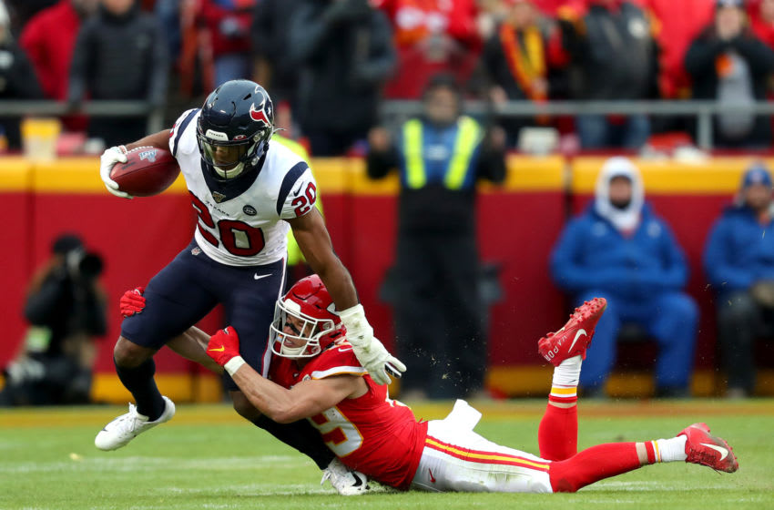 KANSAS CITY, MISSOURI - JANUARY 12: Justin Reid #20 of the Houston Texans is tackled by Daniel Sorensen #49 of the Kansas City Chiefs on a fake punt attempt during the second quarter in the AFC Divisional playoff game at Arrowhead Stadium on January 12, 2020 in Kansas City, Missouri. (Photo by Tom Pennington/Getty Images)