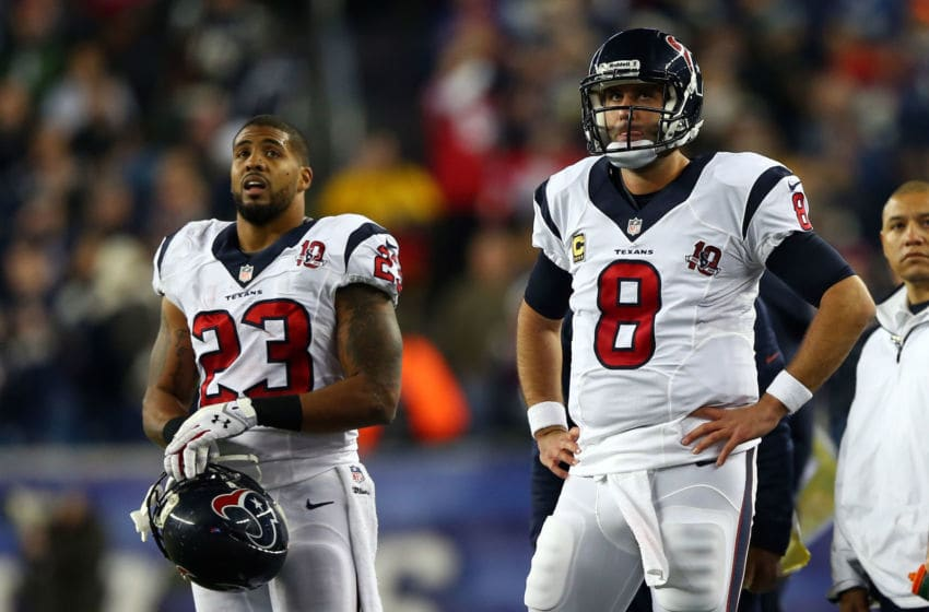 FOXBORO, MA - JANUARY 13: Matt Schaub #8 and Arian Foster #23 of the Houston Texans look on from the sideline against the New England Patriots during the 2013 AFC Divisional Playoffs game at Gillette Stadium on January 13, 2013 in Foxboro, Massachusetts. (Photo by Elsa/Getty Images)