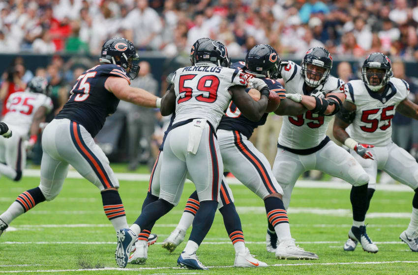 HOUSTON, TX - SEPTEMBER 11: Whitney Merciless #59 of the Houston Texans strips the ball away from Jay Cutler #6 of the Chicago Bears as J.J. Watt #99 and Benardrick McKinney #55 apply pressure in the fourth quarter during a NFL football game at NRG Stadium on September 11, 2016 in Houston, Texas. (Photo by Bob Levey/Getty Images)