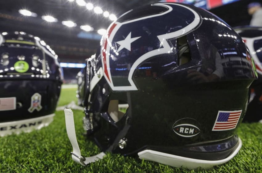 HOUSTON, TX - NOVEMBER 26: A view of the helmet sticker honoring Robert C. McNair, the late owner of the Houston Texans, is shown prior to the game against the Tennessee Titans at NRG Stadium on November 26, 2018 in Houston, Texas. (Photo by Tim Warner/Getty Images)