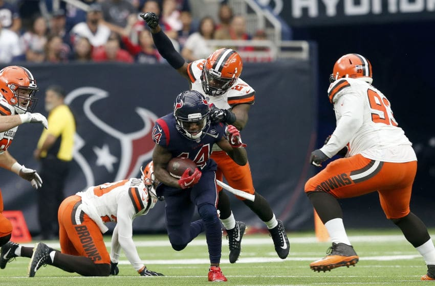 HOUSTON, TX - DECEMBER 02: Derrick Kindred #26 of the Cleveland Browns leaps to tackle DeAndre Carter #14 of the Houston Texans in the third quarter at NRG Stadium on December 2, 2018 in Houston, Texas. (Photo by Tim Warner/Getty Images)