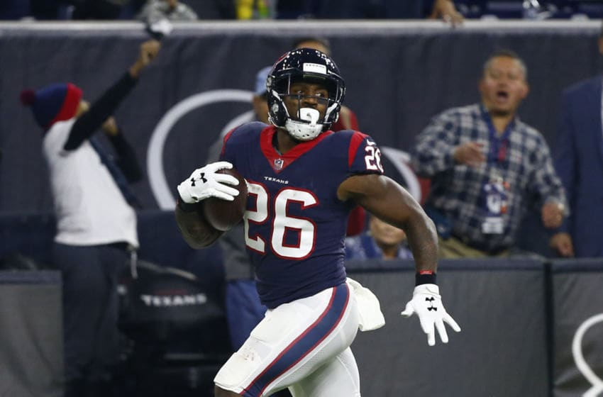 Lamar Miller #26 of the Houston Texans - (Photo by Bob Levey/Getty Images)