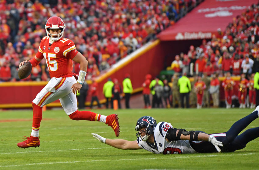 KANSAS CITY, MISSOURI - JANUARY 12: Quarterback Patrick Mahomes #15 of the Kansas City Chiefs rolls out in the first half during the AFC Divisional playoff game against defensive end J.J. Watt #99 of the Houston Texans at Arrowhead Stadium on January 12, 2020 in Kansas City, Missouri. (Photo by Peter G. Aiken/Getty Images)
