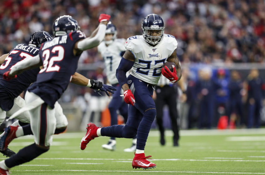 HOUSTON, TX - DECEMBER 29: Derrick Henry #22 of the Tennessee Titans runs the ball in the first half against the Houston Texans at NRG Stadium on December 29, 2019 in Houston, Texas. (Photo by Tim Warner/Getty Images)