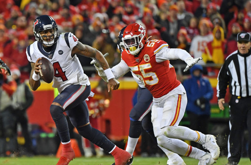 Deshaun Watson #4 of the Houston Texans scrambles away form defensive end Frank Clark #55 of the Kansas City Chiefs (Photo by Peter G. Aiken/Getty Images)