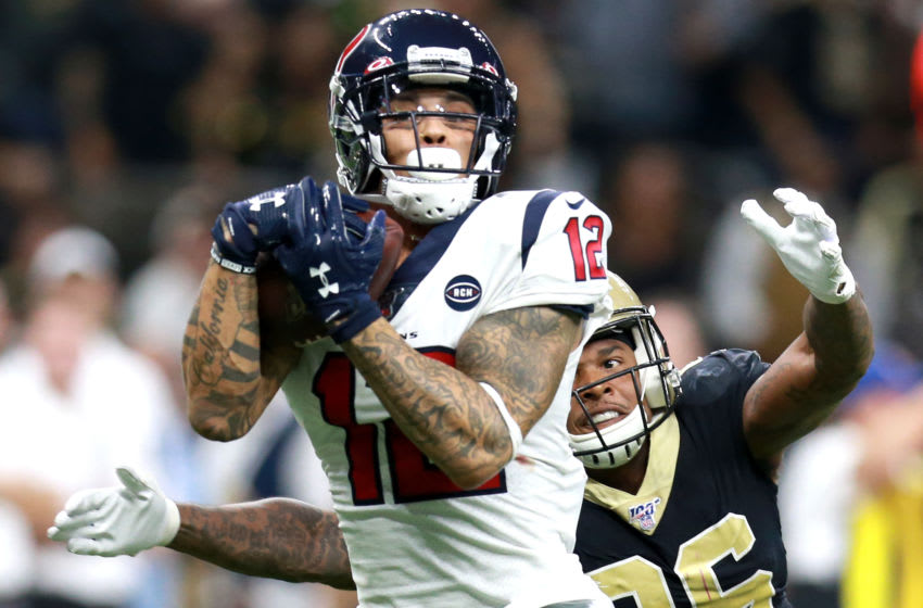 NEW ORLEANS, LOUISIANA - SEPTEMBER 09: Kenny Stills #12 of the Houston Texans catches a touchdown pass over P.J. Williams #26 of the New Orleans Saints during a NFL game at the Mercedes Benz Superdome on September 09, 2019 in New Orleans, Louisiana. (Photo by Sean Gardner/Getty Images)