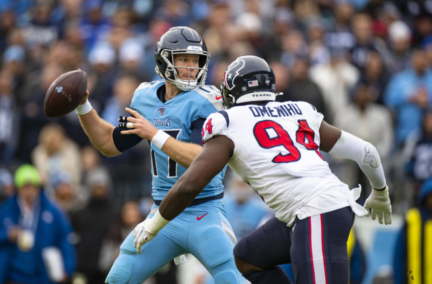 NASHVILLE, TN - DECEMBER 15: Ryan Tannehill #17 of the Tennessee Titans looks for receivers as he is pressured by Charles Omenihu #94 of the Houston Texans during the third quarter at Nissan Stadium on December 15, 2019 in Nashville, Tennessee. Houston defeats Tennessee 24-21. (Photo by Brett Carlsen/Getty Images)