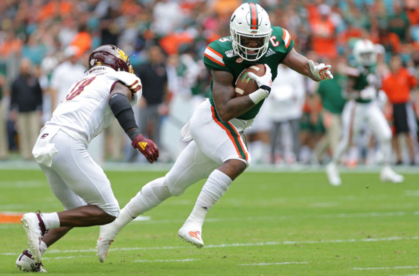 Sep 21, 2019; Miami Gardens, FL, USA; Miami Hurricanes tight end Brevin Jordan (9) carries the ball as he tries to avoid a tackle from Central Michigan Chippewas defensive back Kyron McKinnie-Harper (18) in the first quarter of a football game at Hard Rock Stadium. Mandatory Credit: Sam Navarro-USA TODAY Sports