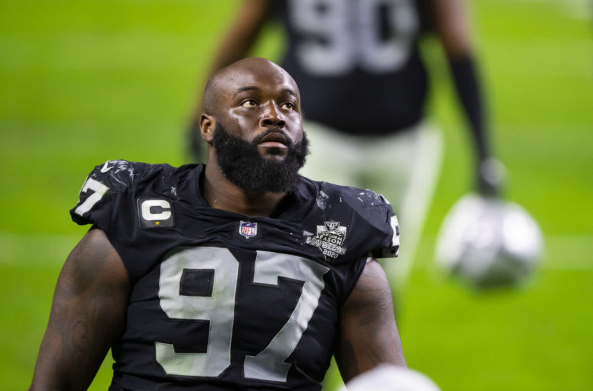 Defensive tackle Maliek Collins (97) signs with the Houston Texans Mandatory Credit: Mark J. Rebilas-USA TODAY Sports