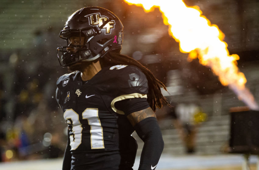 Oct 3, 2020; Orlando, Florida, USA; UCF Knights defensive back Aaron Robinson (31) runs out of the tunnel during team introductions before a game against the Tulsa Golden Hurricane at Spectrum Stadium. Mandatory Credit: Mary Holt-USA TODAY Sports